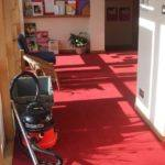 red carpet in school entrance reception area