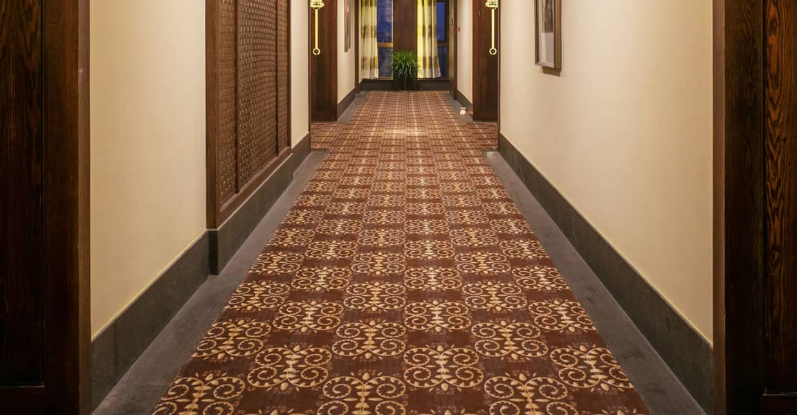 long hallway with traditional pattern carpet